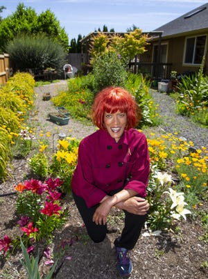 Robin Brown-Wood, the spirit behind Alma Catering, has had a little more time to work in her garden in Eugene since the COVID-19 pandemic. [Chris Pietsch/The Register-Guard] - registerguard.com