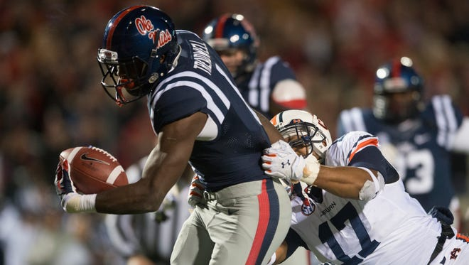 Auburn linebacker Kris Frost (17) tackled Mississippi wide receiver Laquon Treadwell (1) forcing a fumble on the goal line during the NCAA football game at University of Mississippi in Oxford, Miss., on Saturday, Nov. 1, 2014. Auburn defeated Mississippi 35-31