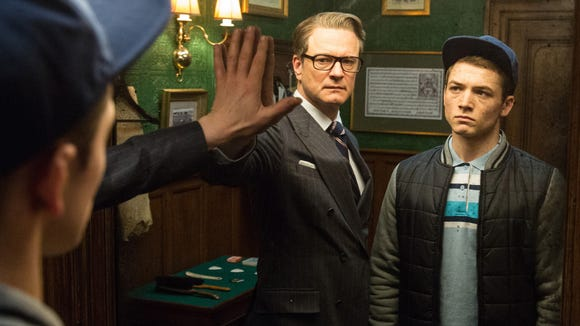 Harry (Colin Firth) helps Eggsy (Taron Egerton) in