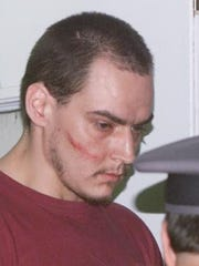 Elmira Correctional Facility escapee Timothy Morgan, then 26, is taken from the New York State Police barracks in Horseheads July 8, 2003, back to Elmira, N.Y. Correctional Facility. State police apprehended Morgan and Timothy Vail, 35, two convicted murderers who escaped from a maximum-security prison by scaling down the side of the building using a rope made from bed sheets, officials said.