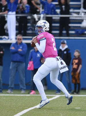 Chase Wolf drops back to pass for St. Xavier.
