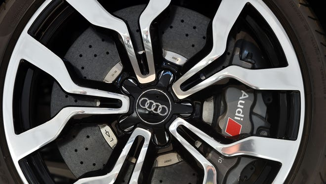 This file photo taken on May 18, 2017 shows the logo of the German car producer Audi on a wheel of a car displayed at Audi's annual general meeting in Neckarsulm, Germany.