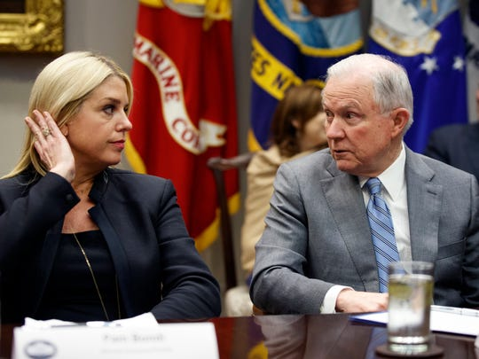 U.S. Attorney General Jeff Sessions, right, talks with Florida Attorney General Pam Bondi before a meeting with President Donald Trump and state and local officials to discuss school safety, in the Roosevelt Room of the White House on Feb. 22, 2018, in Washington