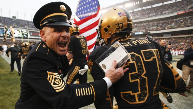 West Point Command Sgt. Maj. Todd Burnett greets the Black Knights as they take the field for the 113th Army-Navy game at Lincoln Financial Field in Philadelphia, VA on Saturday, December 8, 2012.
