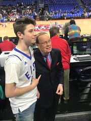Trevor Tuttle, 13, of Clarkston with Pistons broadcaster