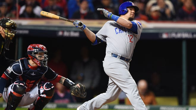 Chicago Cubs player Kyle Schwarber hits a double against the Cleveland Indians in the fourth inning in game one of the 2016 World Series at Progressive Field on Oct. 25.