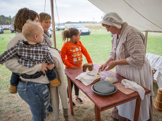 Barbra Davis shows patrons of the Landess Farm in Daleville how to make pioneer style cornbread and butter Sunday afternoon for their fall season festivities. The farm added in the spectacle to add to the Indiana Bicentennial celebration.