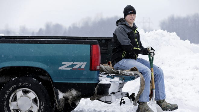 Jonny Bradle of Freedom spent Monday night and early Tuesday morning with a group of friends helping drivers stranded in the snow in the Fox Cities. Bradle's group was on the road from 8 p.m. until 6 a.m. and helped dig out more than 50 vehicles.