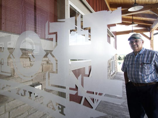 Duane Hord poses for a photo outside of his new visitor center.