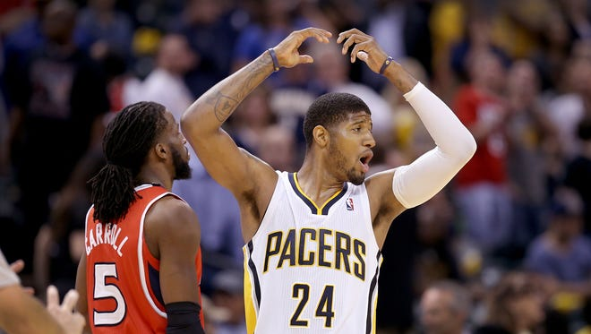 Pacers forward Paul George reacts to falling to the Hawk during the second half of action. Indiana Pacers play the Atlanta Hawks in game 5 of their Eastern Conference playoff game April 28, 2014 at Bankers Life Fieldhouse. The Pacers fell to the Hawks 107-97.