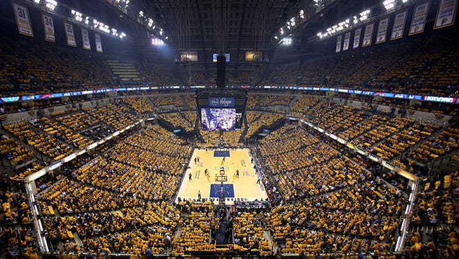Indiana Pacers fans pack Bankers Life Fieldhouse while wearing 18,165 gold shirts against the Miami Heat during Game 2 of the Eastern Conference Finals May 20, 2014.