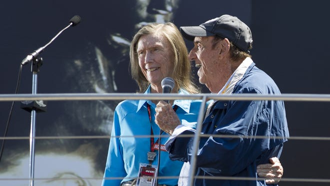 Mari Hulman George and Jim Nabors embrace as they give the traditional signal for teams to start their engines May 24, 2014, at the Indianapolis Motor Speedway's Indianapolis 500 race.