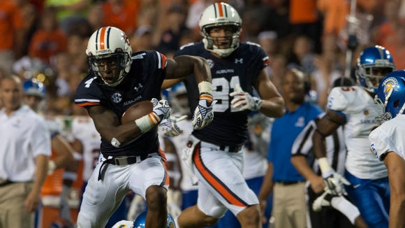 Auburn wide receiver Quan Bray (4) returns a punt 55-yards for a touchdown during the NCAA football game between Auburn and San Jose State on Saturday, Sept. 6, 2014, at Jordan-Hare Stadium in Auburn, Ala.