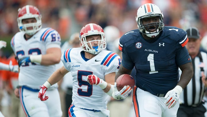 Auburn defensive lineman Montravius Adams (1) returns an interception as Louisiana Tech wide receiver Trent Taylor (5) chases him down during the NCAA football game between Auburn and Louisiana Tech on Saturday, Sept. 27, 2014 in Auburn, Ala.