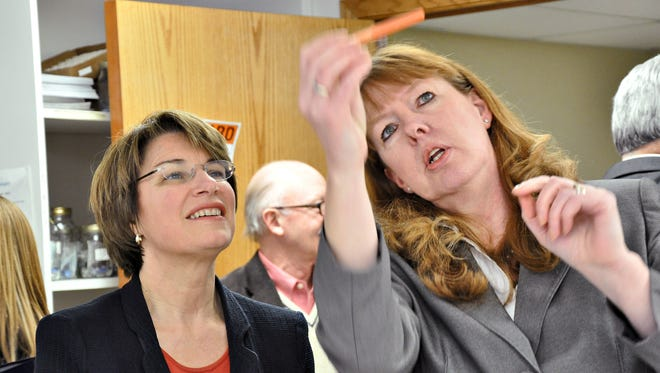 Donna Scholer, chief operations officer at Microbiologics, (right) showed one of her company's products to U.S. Sen. Amy Klobuchar and others during a 2013 tour. Microbiologics will play host to representatives from more than 20 different nations next week for a technical training program.