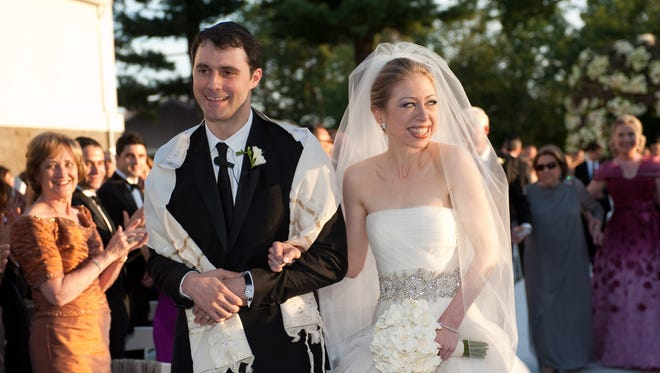 In this photo provided by Genevieve de Manio Photography, Chelsea Clinton and Marc Mezvinsky are seen during their wedding, Saturday, July 31, 2010 in Rhinebeck, N.Y.  Chelsea Clinton wed her longtime boyfriend under extraordinary security at an elegant Hudson River estate late Saturday.