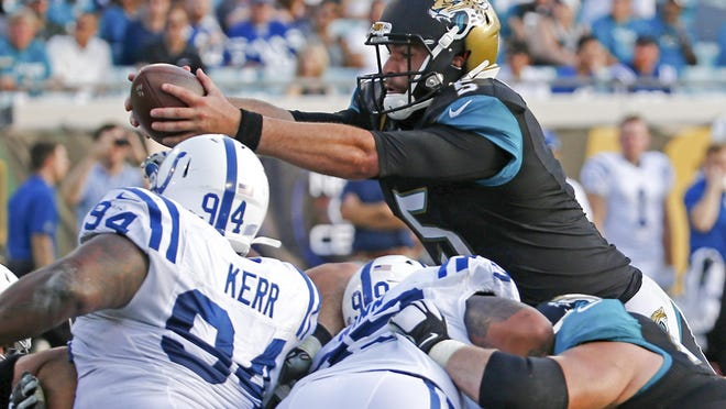 Stephen B. Morton/APJaguars quarterback Blake Bortles, top right, dives over the Indianapolis Colts line for a touchdown Sunday. Jacksonville won 51-16. Jacksonville Jaguars quarterback Blake Bortles, top right, dives over the Indianapolis Colts line for a touchdown during the second half of an NFL football game in Jacksonville, Fla., Sunday, Dec. 13, 2015. Jacksonville won 51-16. (AP Photo/Stephen B. Morton)