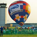 The HBC Contracting Balloon lands during the Field of Flight Thursday night.