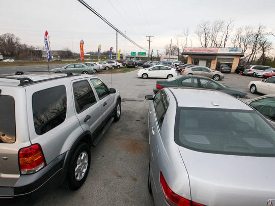 The owner of iMotors Delaware says dust from previous construction work along I-295 exit to Route 13 continues to collect on his cars at his lot.