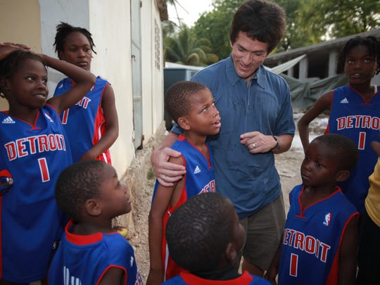 Mitch Albom makes his good-byes to Kevin Gedeon, 8  and other children before leaving the Caring & Sharing Mission in Port-Au-Prince, Haiti to return to Michigan on April 30, 2010.