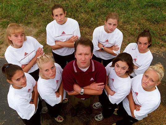 Text: 1999.0825.03.2 CROSSCOUNTRY SPORTS The Colerain High School girls cross country team is going for the third straight state title with from the left front, Alison Zeinner, Kelly Crum, coach Ron Russo, Alison Bedingfield, Catie Grebe, back from left, JenniferLimle, Terie Littlepage, Shelly Dickinson and and Lori Siconolfi. PHOTO BY Tony Jones / Cincinnati Enquirer.tj