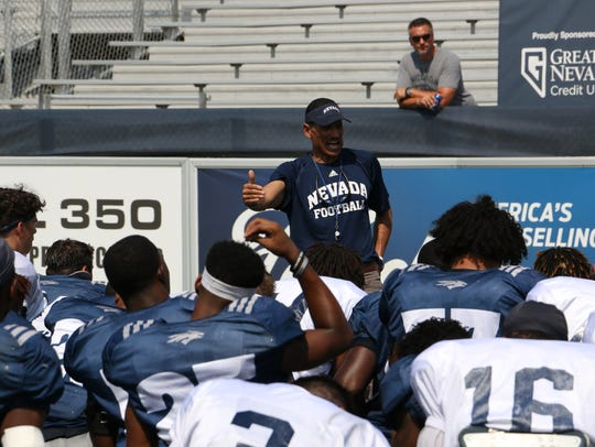 Head coach Jay Norvell addresses his players following Nevada's scrimmage at Mackay Stadium in August.