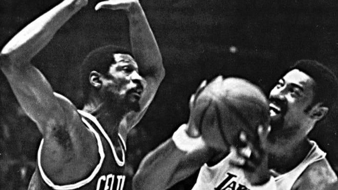 Boston Celtics center Bill Russell (Ieft) defends against Wilt Chamberlain.