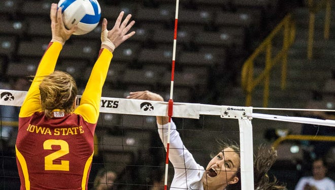 Iowa State's Mackenzie Bigbee (left) brings strong blocking skills as well as powerful hitting. She led the Cyclones to a win over Iowa last season.