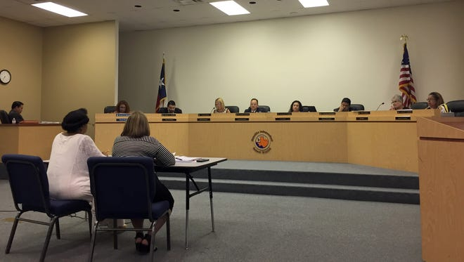 Canutillo Independent School District trustees listen to a budget and employee compensation plan by CISD Chief Financial Officer Martha Piekarski, front left, and Martha Carrasco.