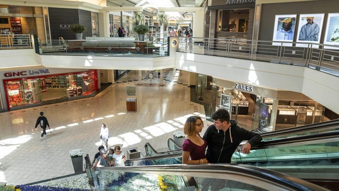 The Gardens Mall, pictured in March just before it closed amid coronavirus concerns, will reopen May 15.