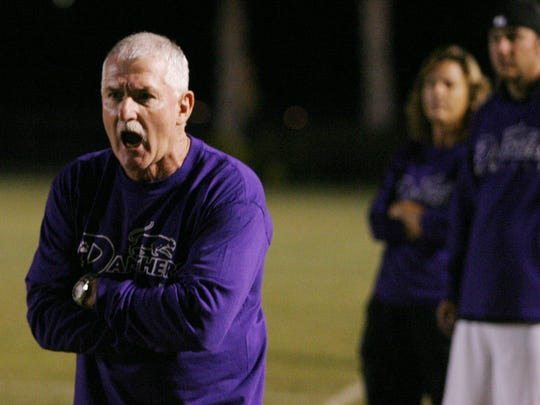 Cypress Lake High School girls soccer coach Pat Farrell delivers instruction to his team during a game against Ida Baker on Friday, December 20, 2007.