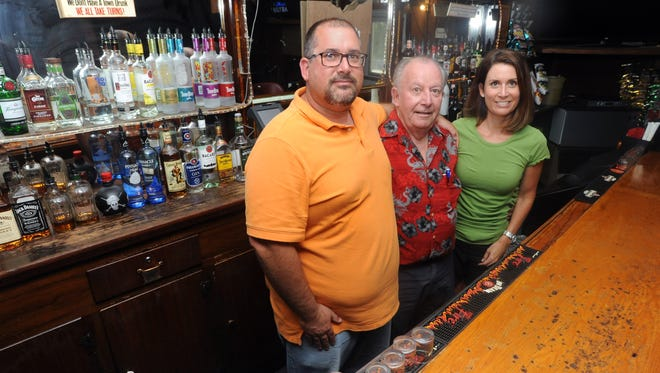 Bill Allen, owner of the Cozy Inn, center, is selling the business with help from his son, Matt Allen, left, and daughter, Stephanie Miller. Allen has owned the Cozy Inn for 38 years.