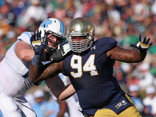 Jarron Jones #94 of the Notre Dame Fighting Irish rushes against Jon Heck #71 of the North Carolina Tar Heels at Notre Dame Stadium on October 11, 2014 in South Bend, Indiana.