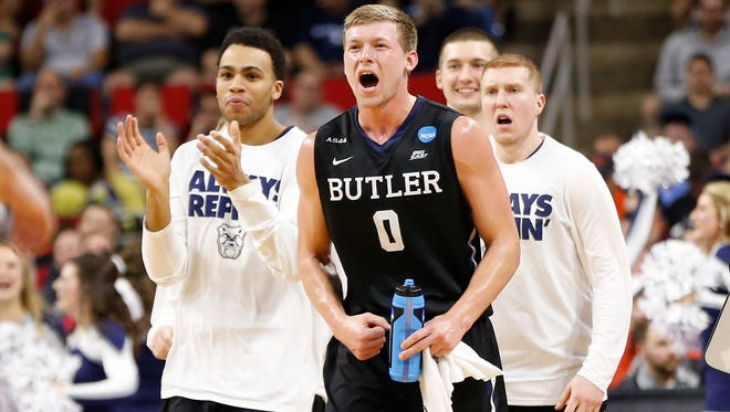 Mar 17, 2016; Raleigh, NC, USA; Butler Bulldogs forward Austin Etherington (0) and teammates celebrates after the Bulldogs' score against the Texas Tech Red Raiders during the second half at PNC Arena. Mandatory Credit: Geoff Burke-USA TODAY Sports