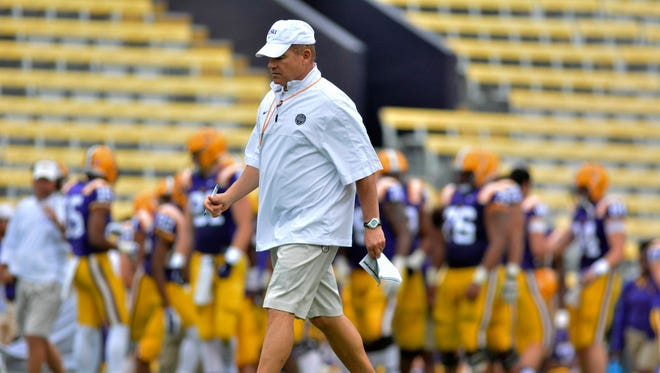 LSU Tigers head coach Les Miles walks across the field during the Spring Game at Tiger Stadium.