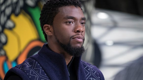 "HOThis image released by Disney and Marvel Studios' shows Chadwick Boseman in a scene from ""Black Panther,"" in theaters on Feb. 16, 2018. (Matt Kennedy/Marvel Studios/Disney via AP) ORG XMIT: CAET866"