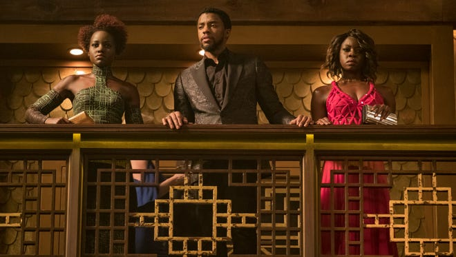 """This image released by Disney and Marvel Studios' shows Lupita Nyong'o, from left, Chadwick Boseman and Danai Gurira in a scene from """"Black Panther,"""" in theaters on Feb. 16, 2018. (Matt Kennedy/Marvel Studios/Disney via AP) ORG XMIT: CAET867"""