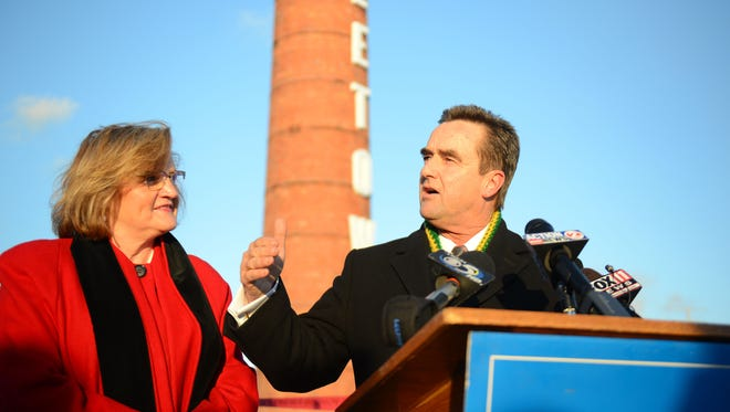Green Bay Mayor Jim Schmitt announces his candidacy for a fourth term as mayor Thursday from the roof of the Titletown Brewery with his wife Dona.