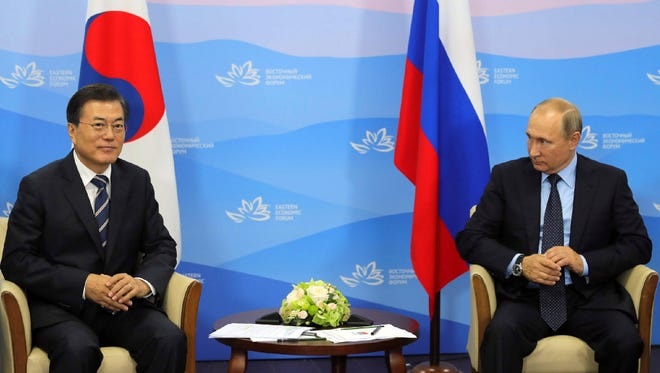 Russian President Vladimir Putin, right, with South Korean President Moon Jae In during their meeting at the Eastern Economic Forum in Vladivostok, Russia, on Sept. 6.