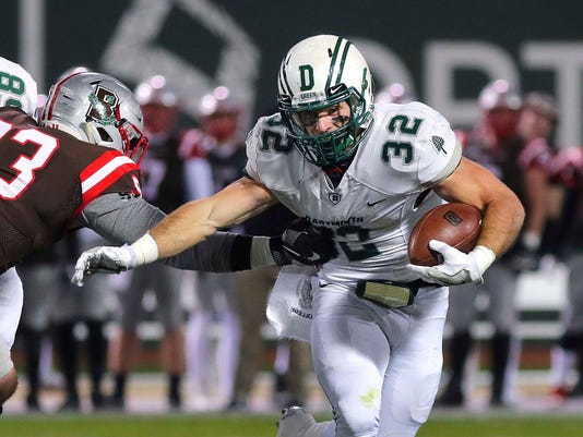 Dartmouth's Ryder Stone carries the ball for gain as Brown's Michael Hoecht moves in for the tackle during an NCAA college football game Friday, Nov. 10, 2017, in Boston. (John Tlumacki/The Globe via AP).