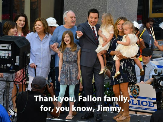 "Jimmy Fallon and family on stage at the April 6 Grand Opening for ""Race Through New York Starring Jimmy Fallon"" at Universal Orlando Resort."