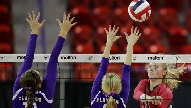 Newman Catholic's Mariah Whalen (10) gets a kill against Clayton in the Division 4 championship match at the WIAA state girls volleyball tournament at the Resch Center on Saturday, November 5, 2016, in Ashwaubenon, Wis. Newman Catholic won the championship with a 3-0 victory.