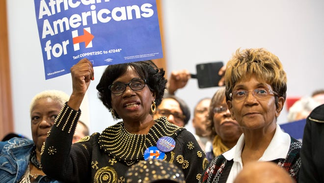 Women cheer during a rally for Democratic presidential candidate Hillary Clinton at the Central Baptist Church in Columbia, S.C., on Tuesday, Feb. 23, 2016. (AP Photo/Jacquelyn Martin)