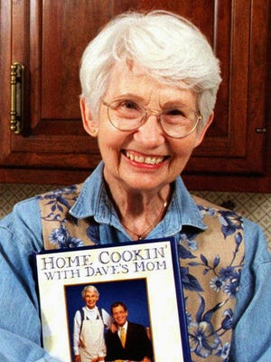 "Dorothy Mengering, better known as David Letterman's mom, shows off her cookbook, ""Home Cookin' with Dave's Mom,"" in April 1996."