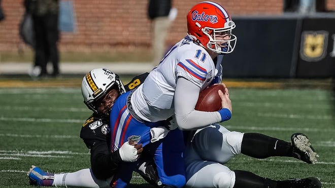 Missouri's Kobie Whiteside (78) sacks Florida's Kyle Trask (11) during a game Nov. 16 at Faurot Field.