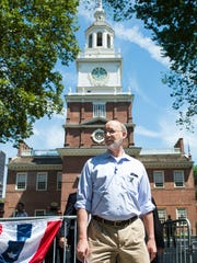 Pennsylvania Governor Tom Wolf walks out of Independence Hall as he went on a walking tour of Historic Philadelphia on Sunday, July 24, 2016.