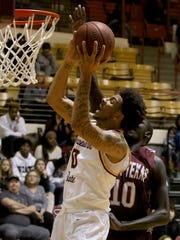 Midwestern State's Brandon Neel puts in a layup against