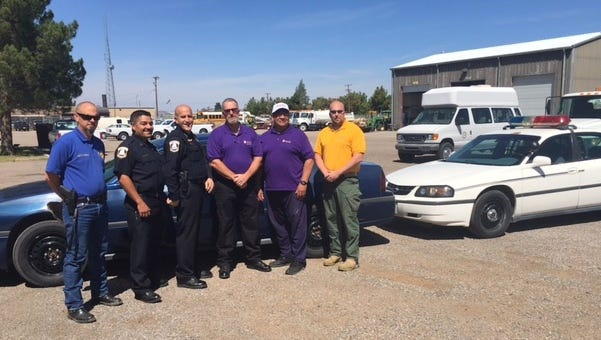 The Deming Police Department donated two of its retired 2003 Chevrolet Impalas to the Western New Mexico University law Enforcement Academy. Pictured, from left, are:  DPD Administrative Captain, Clint Hogan; DPD Patrol Captain, Alex Valdespino; DPD Chief of Police, Bobby Orosco; WNMU Adjunct Professor, Steve Reese; Academy Director, Gilbert Najar; and  WNMU Adjunct Professor, Chad Pavola.