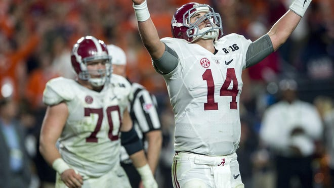 Alabama quarterback Jake Coker celebrates following the final touchdown against Clemson in the College Football Playoff Championship Game on Jan. 11.