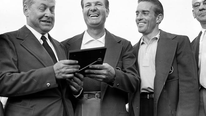 Bob Jones, president of Augusta National Golf Club, left, presents a plaque to Jimmy Demaret (center) as amateur Frank Stranahan, at right, and Clifford Roberts look on after Demaret's victory in the 1950 Masters.